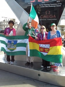 Limerick and Carlow Association members share the podium at a London Olympic event.