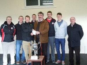 niall-sheehan-presents-the-carlow-association-london-sponsorship-cheque-to-eddie-byrne-surrounded-by-club-players-and-officials